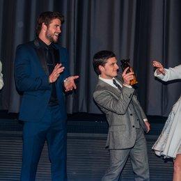 Tribute von Panem - Catching Fire, Die / Filmpremiere / Elizabeth Banks / Liam Hemsworth / Woody Harrelson / Jennifer Lawrence Poster