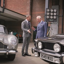 UNIVERSAL SELECT Prince Charles visits B25 at Pinewood Studios 20/6/2019 and meets James Bond, Daniel Craig and sees two of the cars featured in the film, Aston Martin DB5 and Aston Martin V8 Vantage Poster