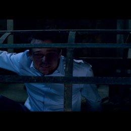 Im Käfig - Szene