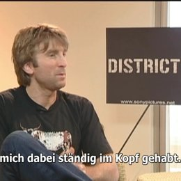EXKLUSIV: Sharlto Copley über DISTRICT 9 - Interview Poster