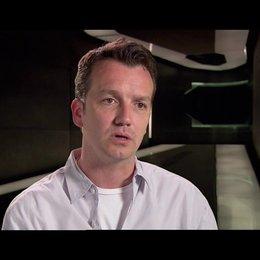 Sean Bailey (Producer) über die Erschaffung der Welt von Tron Legacy - OV-Interview Poster