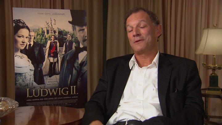 Ronald Mühlfellner über eine Begegnung mit japanischen Touristen in Neuschwanstein - Interview Poster