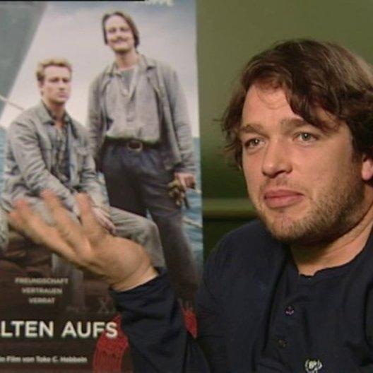 Ronald Zehrfeld (Matthias Schönherr) über die Gefängnisszenen - Interview Poster